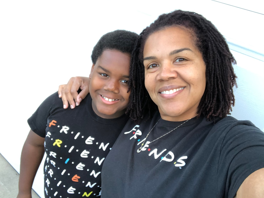 """Chauna and her son, Chase with their arms around each other. Both are wearing shirts that say """"Friends"""""""